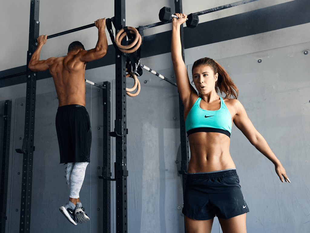 fitness couple making upper body exercise routines at gym