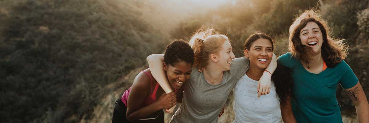 versatile Group of  young girl friends going outdoor to making exercise