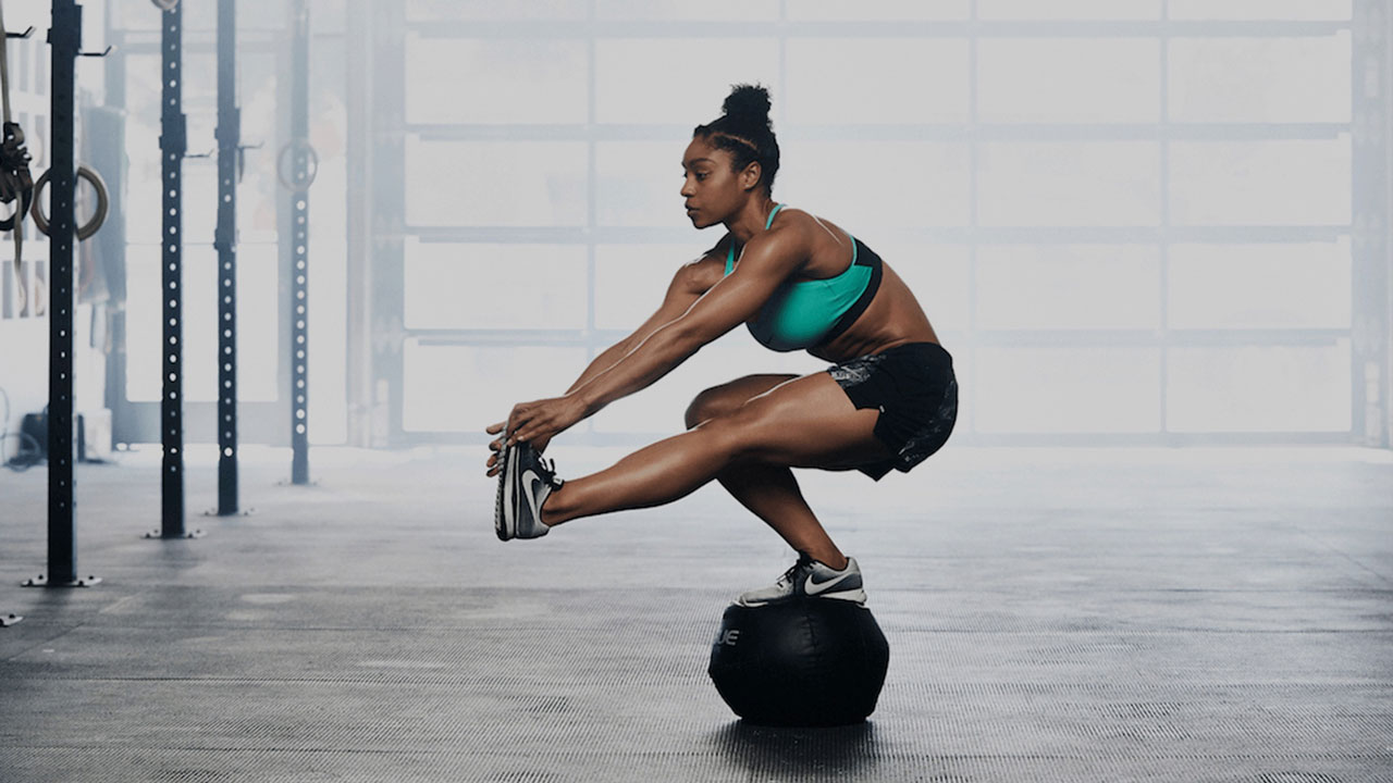 woman doing ball for lower body strength exercises