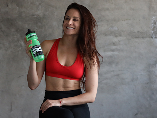Fitness woman with ABS hydrating with Herbalife24 BCAAs